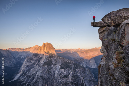 Hiker at Glacier Point at sunset, Yosemite National Park, California, USA Poster