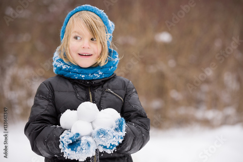 3d20126fe Portrait of adorable little kid boy with long blond hair playing ...