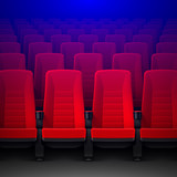 Movie theater with rows of red empty chairs and spotlight, cinema hall seats