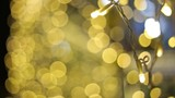 Defocused night street lights blurred colorful bokeh background. Holiday colorful lanterns and light bulbs garlands.