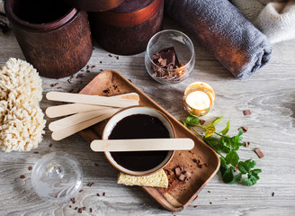 winter spa with darl chocolate for body massage