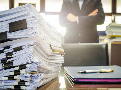 Poster Close up of business documents stack on businessman background