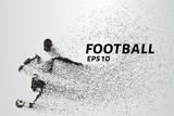 Football of the particles carries in the wind. Silhouette of a football player from circles. - 133685349
