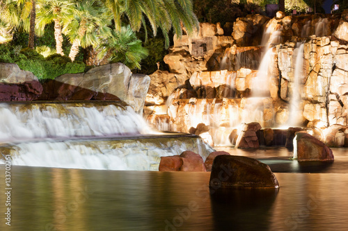 Fountain is in Las Vegas. Night city landscape with waterfall.