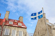 Quebec flag in front of a old house of Quebec City, in the Lower Town (basse ville)