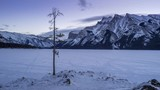 Early morning time lapse of scenic Minnewanka Lake in Banff National Park, Alberta Canada.