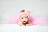 cute little baby girl in a nice pink flared dress - 133771733
