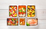 Healthy food take away, top view at wood background