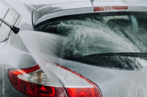 Sticker Cleaning Car Using High Pressure Water.
