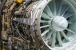 Military fighter Jet engine inside - Airplane gas turbine engine detail - Plane rotor under heavy maintenance.