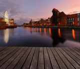 Background with wooden floors and Gdansk cityscape, after sunset