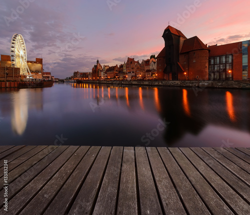 fototapeta na ścianę Background with wooden floors and Gdansk cityscape, after sunset