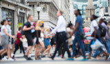 Fototapety Regent street with lots of walking people crossing the road. Blurred image for background