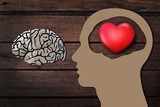 Human head paper cut with 3d Red Heart instead the Brain