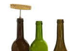 Wine bottles, one of them corked, on white