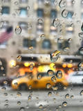 Rain drops on the window with New York City street background