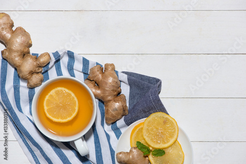 Poster Cup of Ginger Tea with Lemon and Honey on a White Wooden Backgro