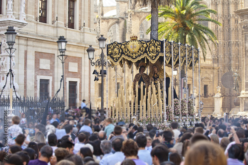 People tacking a virgin on Holy week in Seville, Andalusia, Spain.