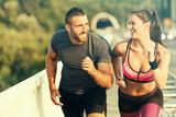 Happy Couple Running Across the Bridge