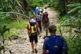 Hiking people walking in rain forest in an adventure tour in Phong Nha - Ke Bang national park, Quang Binh, Vietnam