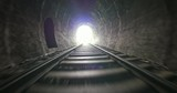 Fast moving camera in dark old railway tunnel toward bright light in the end - 133966115