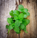 Green fresh mint on the wooden table - 133974163