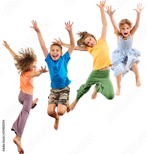 group of happy barefeet cheerful sportive children jumping and dancing