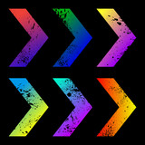 Set of colorful arrows with clipped spots on black background
