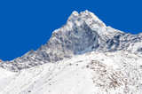 Snowy peak over blue sky (Ama Dablam in the Everest Region)