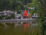 The temples reflected in the lake Revalsar. District Mandi, Himachal Pradesh, district of Kangra, India.