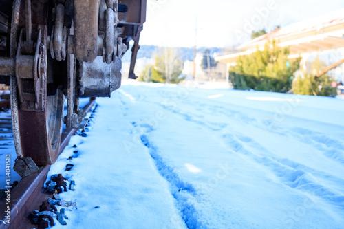 Poster Train closeup on snowy railroad tracks