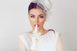 Bride shh Woman wide eyed asking for silence secrecy