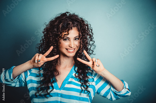 Poster woman giving peace, victory or two sign