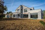 chantier d'une maison en construction - 134053191