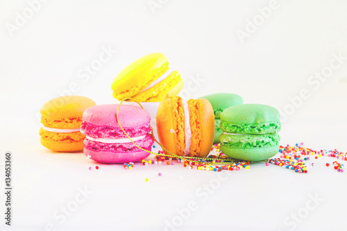 Fotobehang Macarons Macaroons - colorful set with candy dots on white - sweet bakery and pastry. Selective focus.