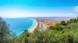 Beautiful panoramic aerial view of beach in City of Nice in sunny summer day. Cote dAzure, France. City of Nice is a famous and luxury resort of French riviera. Time Lapse. 4K UltraHD