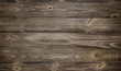 Old weathered wood surface with long boards lined up. Wooden planks on a wall or floor with grain and texture. Dark neutral tones with contrast. - 134065958