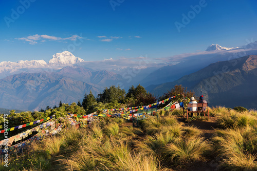 Poster Couple watching the Mt. Dhaulagiri (8,172m) from Poonhill, Nepal.