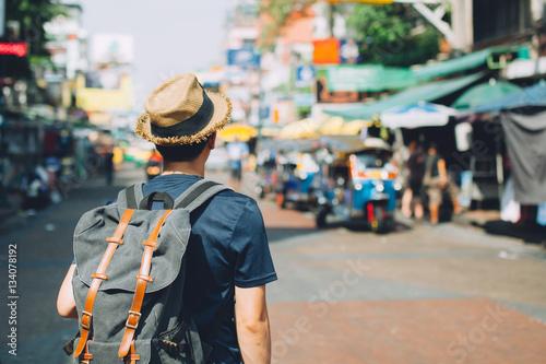 Papiers peints Bangkok Young Asian traveling backpacker in Khaosan Road outdoor market