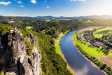 View from viewpoint of Bastei in Saxon Switzerland Germany to the town city and the river Elbe on a sunny day