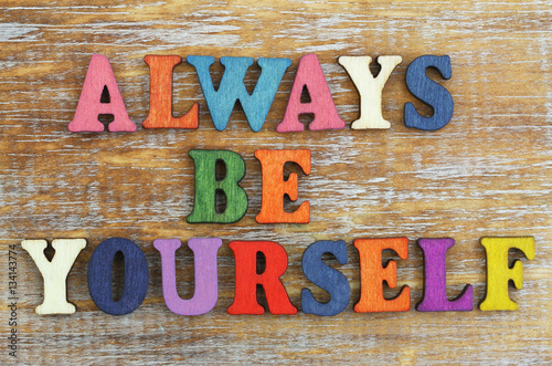 Always be yourself written with colorful wooden letters on rustic surface Poster