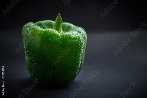 Fresh green pepper on black background - 134156124
