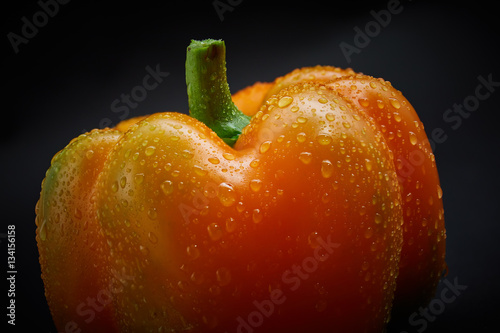 Macro shot of fresh pepper on black background