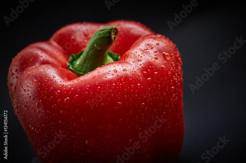 Macro shot of fresh pepper on black background - 134156172