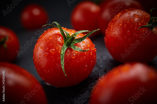Fresh cherry tomatoes on black background Poster
