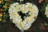 Heart shaped sympathy wreath near a tree