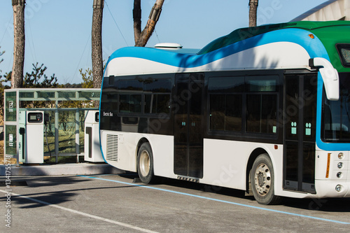 electric vehicle bus stands at the charger. Alternative sources of fuel. - 134175578