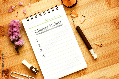 notepad with  pencil  on wooden table for change habits  list co