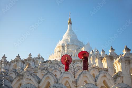 Asian monks sitting under umbrellas at historic temple, Mingun, Mandalay, Myanma Poster