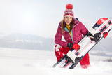 Sport woman  snowboarder on snow over snow scenery